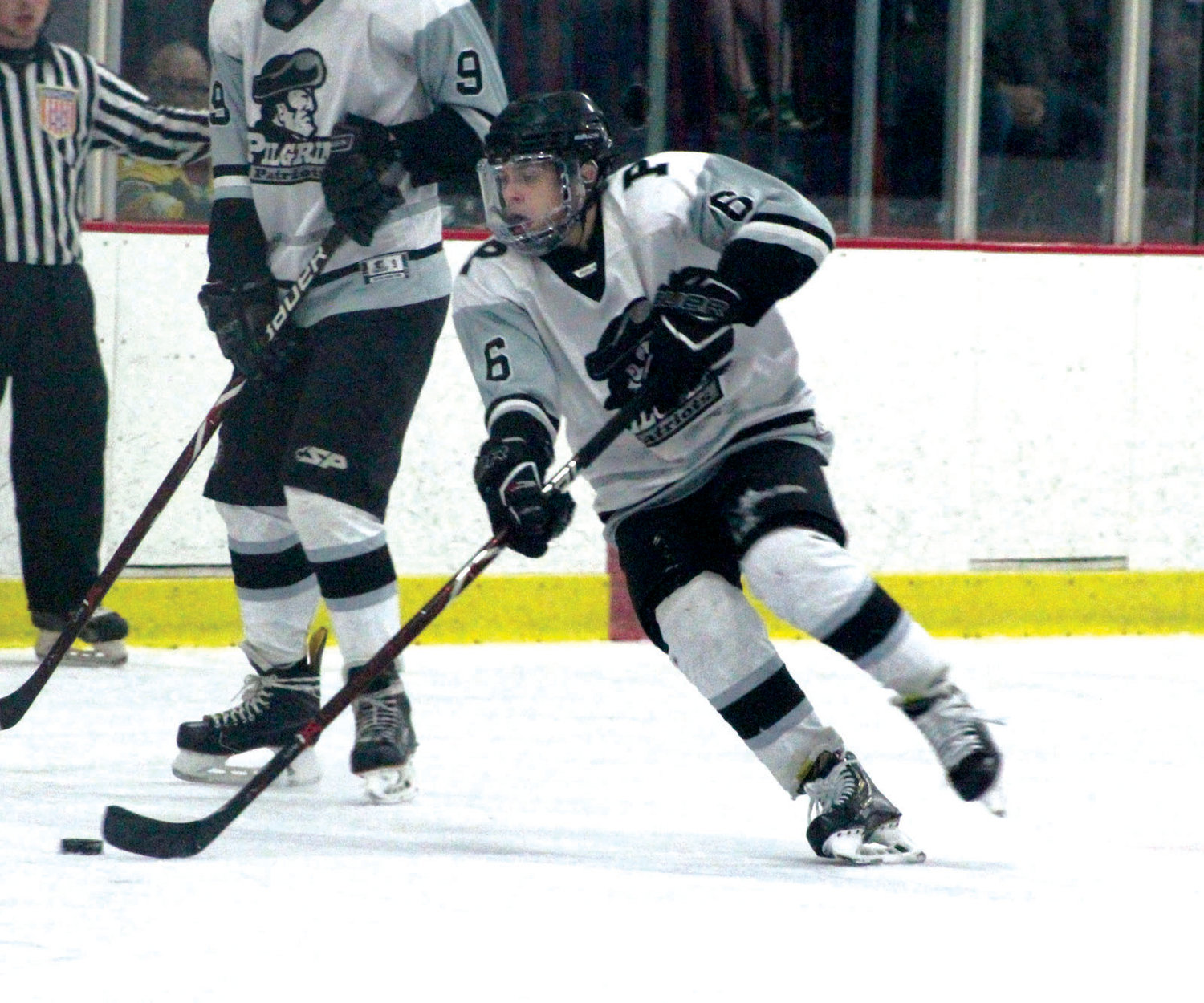 FINALS BOUND: Pilgrim's Collin Driscoll carries the puck up the ice in the Division III Semifinals against Mt. Hope at the Thayer Arena on Tuesday evening.