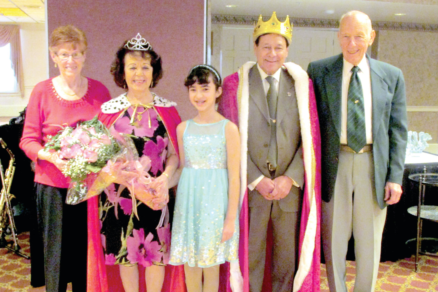 CROWNED COUPLES: Zoila and Manny Guerra, second and fourth from left, respectively, enjoy their royal moment with their granddaughter Daniella after being crowned the Manton Seniors 2018 Queen and King. They're joined by 2017 winners Ann and Bob Gauch.