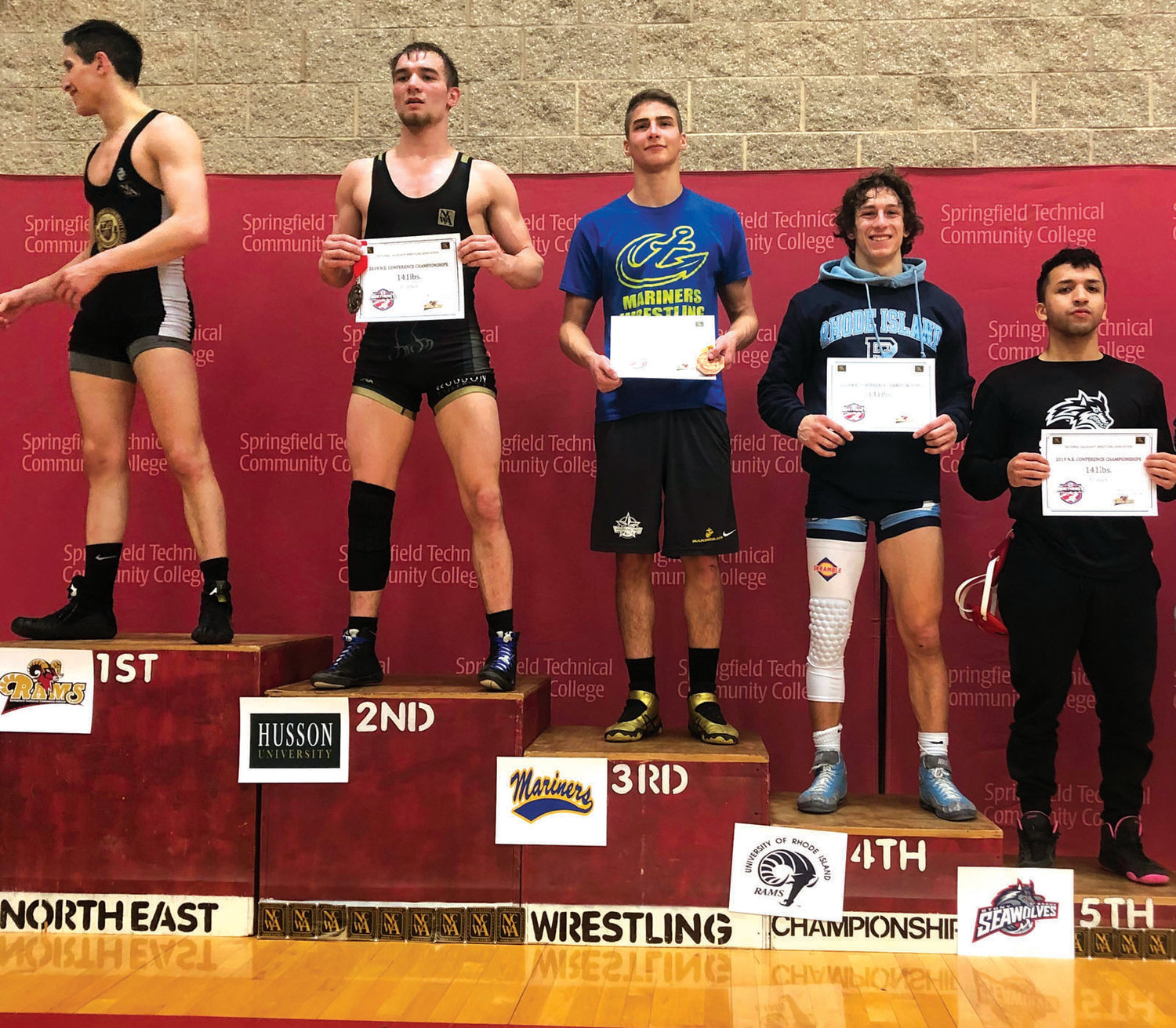 MIGHTY MEDALIST: Johnston's James Baccala (fourth left) stands on the podium showing his award for a fourth place finish in last weekend's regional championships in Springfield, Ma. which earned the former Panther two-sport standout a berth in the March 14-16 NCWA championships in Allen, Texas.