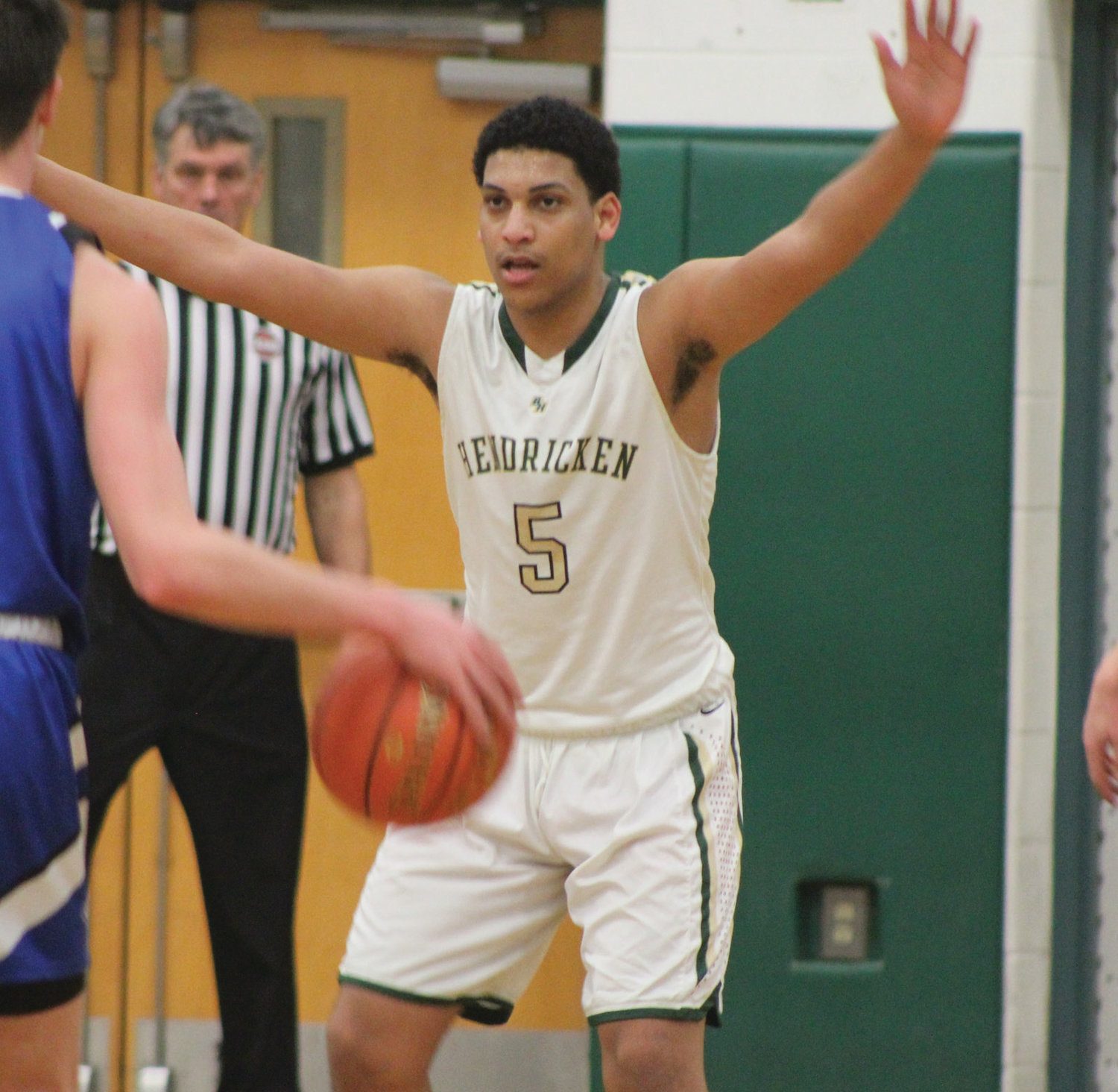 PLAYOFF BASKETBALL: Bishop Hendricken's      Sebastian Basilio defends a Cumberland player in the first round of the open state tournament at Cranston East last week.