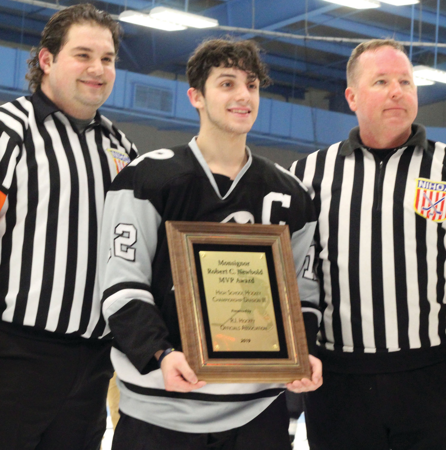 MVP: Pilgrim senior forward Matt Pacheco is presented the Reverend Msgr. Robert C. Newbold Award, given to the most valuable player of the Division III Boys Hockey Championship. Pacheco recorded a goal and an assist in both Games 1 and 2 of the series.