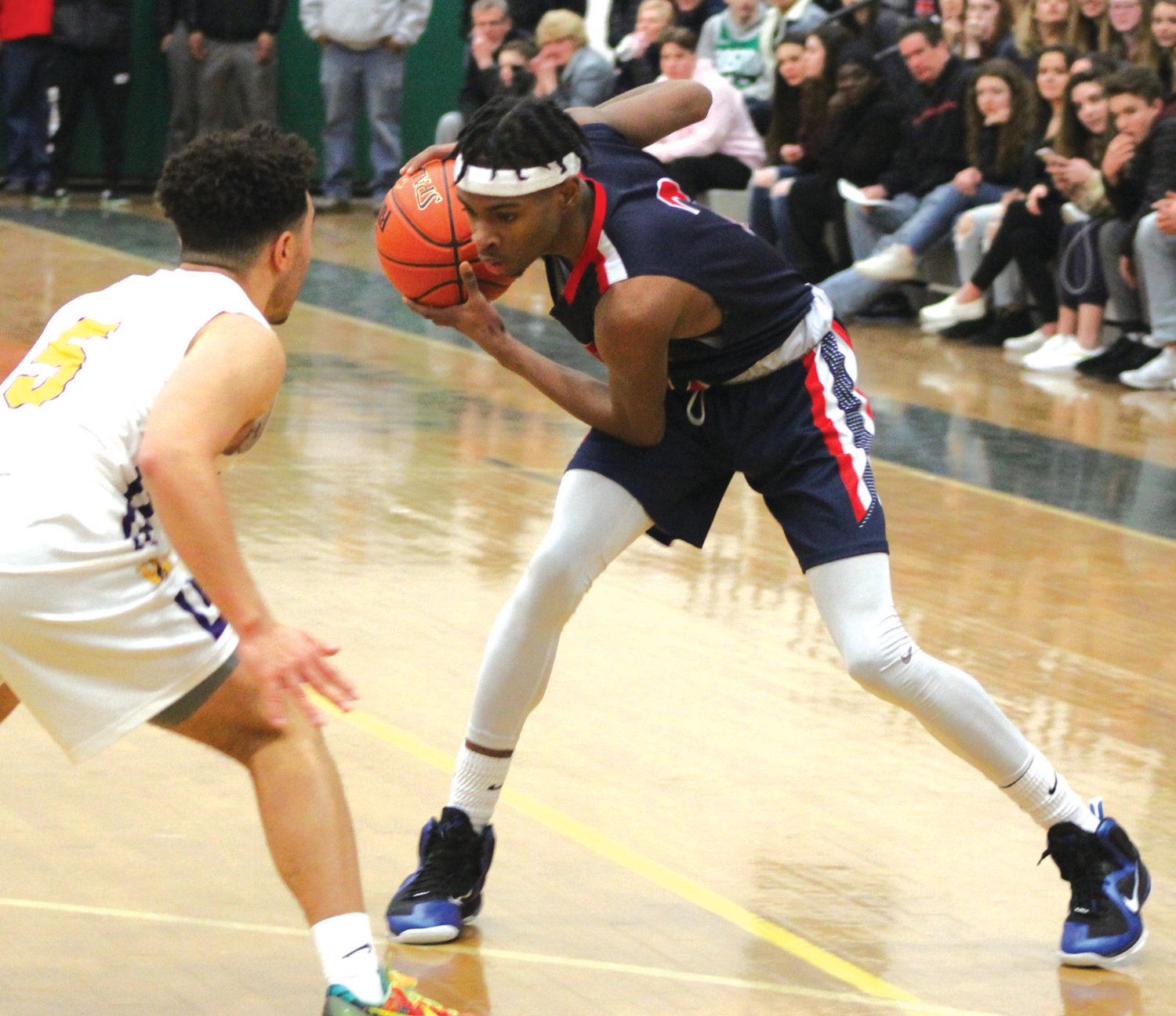 IN THE PAINT: Toll Gate's Kavi Simpson works past a defender during the first round of the open state tournament against Wheeler at Cranston East last week.