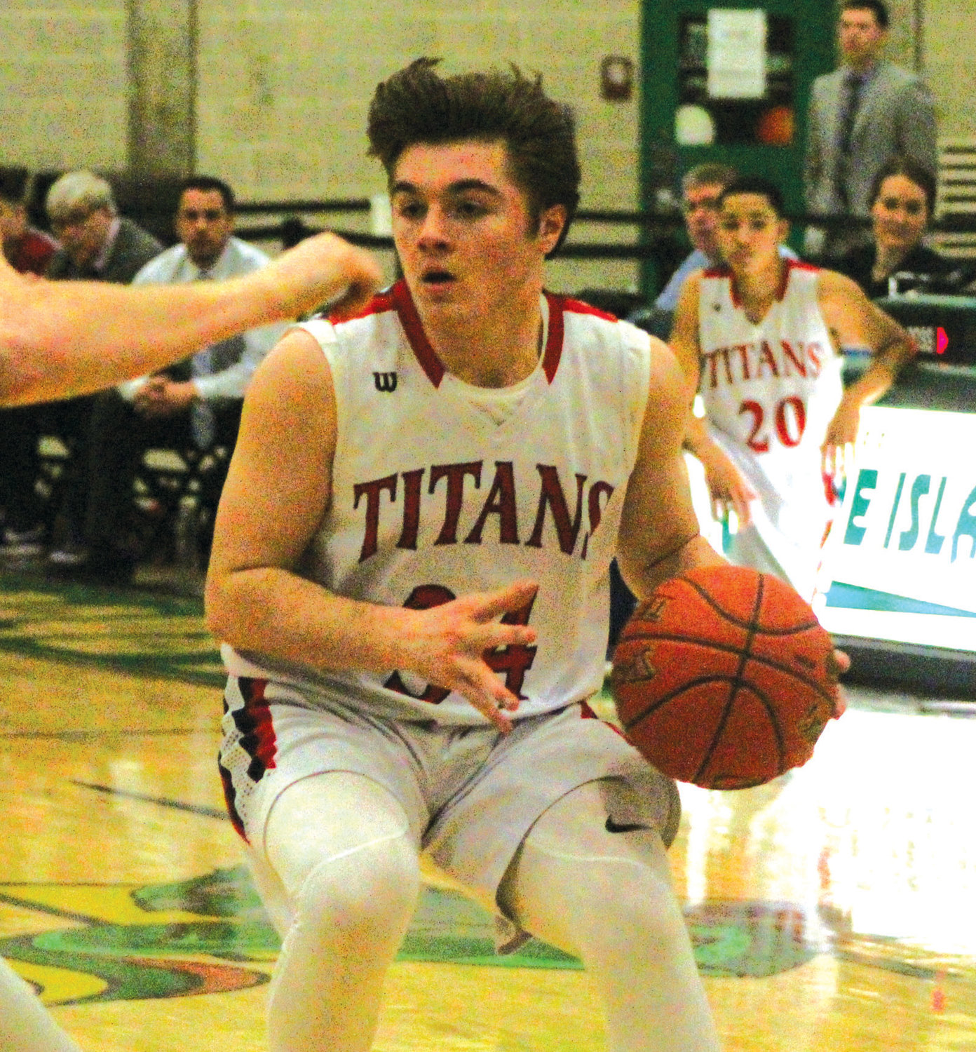 Toll Gate's Austin Noon works his way through traffic against Cumberland in the Elite Eight round at CCRI.