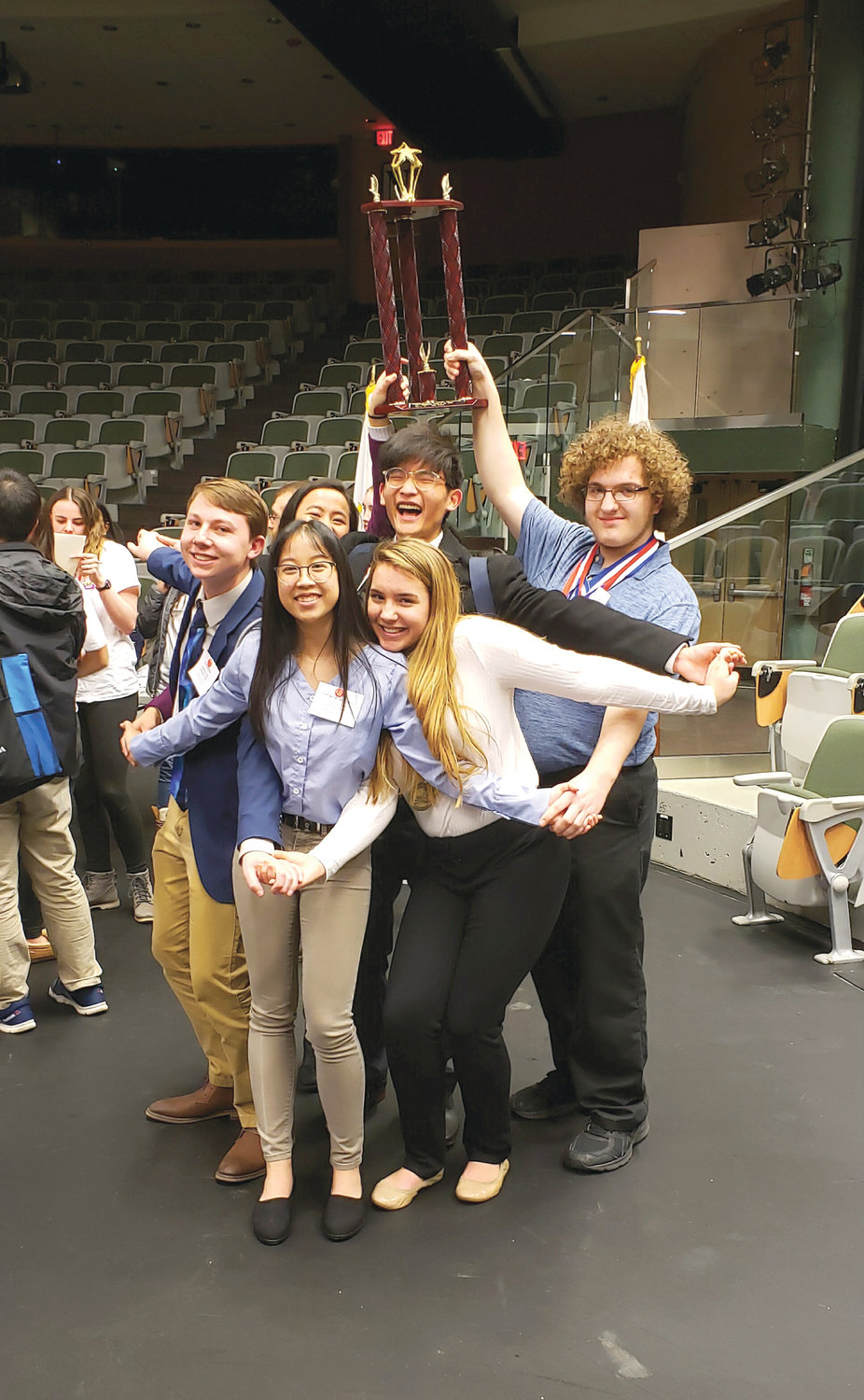 STARRING SENIORS: The senior members of Cranston West's team – Cory Dottor, Allison Vang Inthavha Singharaja, Logan Chin, Hayley McCrystal and Stephen Lemme – celebrate after Sunday's Academic Decathlon.