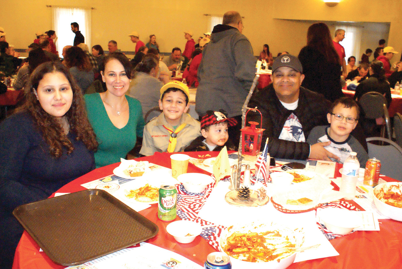 A FAMILY MATTER: Boy Scout Nicholas Espinal of Troop 6 Cranston took time from serving guests to pose with his family during Sunday's dinner. Pictured are 15-year-old Emily, his mother, Cheryl, 10-year-old Nicholas, 2-year-old Evan, his father, Carlos, and 7-year-old Carson.