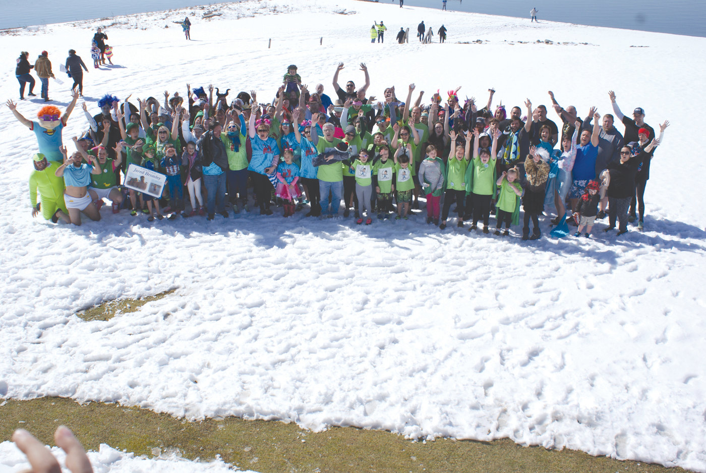 GROUP EFFORT: At last Saturday's Plunge for Preemies to benefit Project Sweet Peas, 130 people of all ages participated in the plunge at the Warwick Country Club. They walked through a snow-covered beach and then took the plunge in 38-degree water.