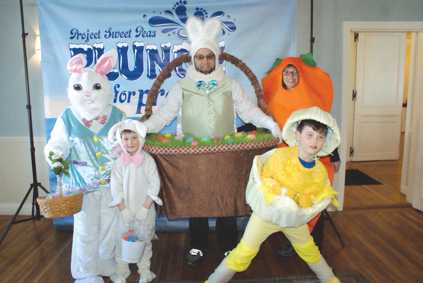 HENRY'S HEREOS: Pictured are members of Team Henry's Heroes dressed up for Easter at the 9th Annual Plunge for Preemies at the Warwick Country Club. They are standing (back row): Pat Lopes, Kevin Powers, Gail Powers and in front are Henry Cook and Jack Cook. Henry was a six-week early preemie who is now 5 years old. All are Warwick residents.