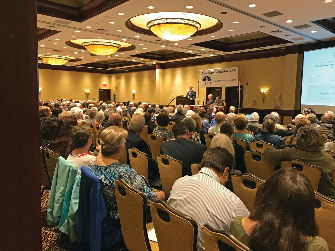 STAKEHOLDERS: A large group listens during the annual Legislative Leaders Forum, organized by the Senior Agenda Coalition and held at the Crowne Plaza in Warwick last Tuesday.