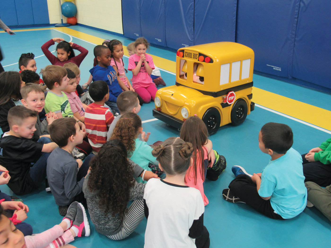 "BUSTER'S BUDDIES: Winsor Hill first-graders Logan Pongvongkeo, Matthew Olivia, Kianne Torres, Lillyannah Coates, Lucia Romano and Victor Mensah say ""goodbye"" and ""thank you"" to Buster the Bus, who thrilled two groups of students during Tuesday's visit to Johnston."