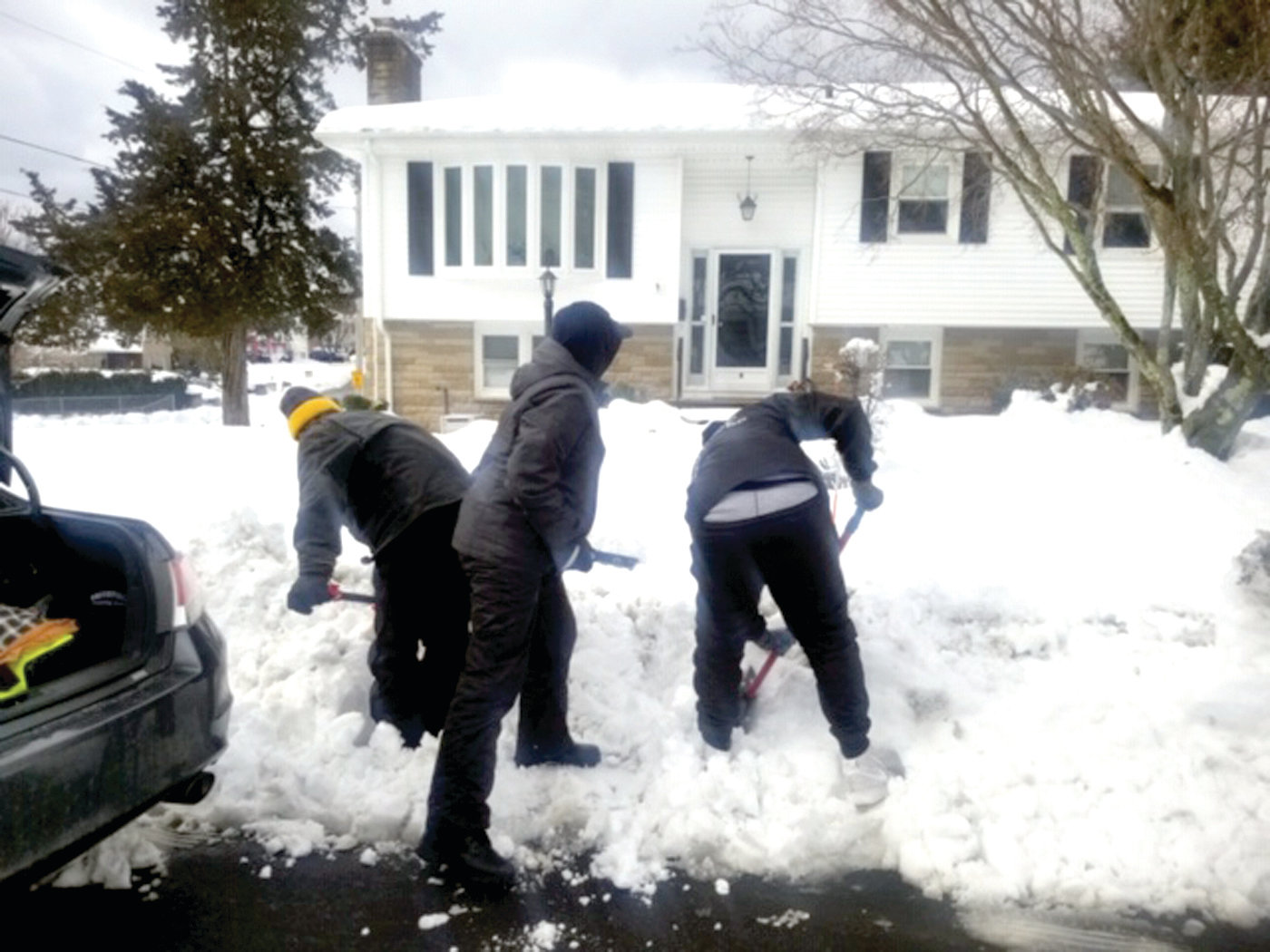 SPECIAL SCENE: The Explorers are hard at work beginning to clear snow from the sidewalk at a senior citizens home.
