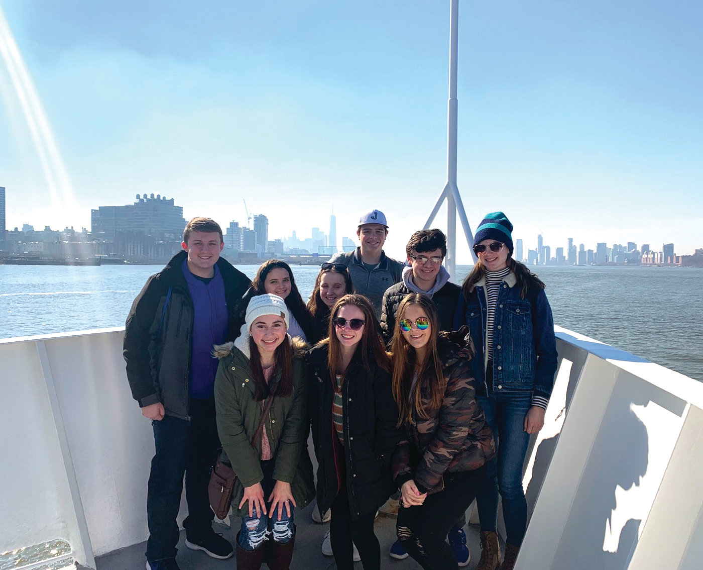 A TRIP TO REMEMBER: (Back row, left to right) Nick Cronan, Giuliana Melise, Gabby Athaide, Justin Salvatore, Nick Petrillo and Brynn Roche posed for a photo with (bottom row, left to right) Grace Centracchio, Brooke Marcotte and Kendall Bernier. Above, Trista Clark, Sarah Monahan, Caleb Lee and Julianna Ferruccio pose for a photo with the Statue of Liberty.