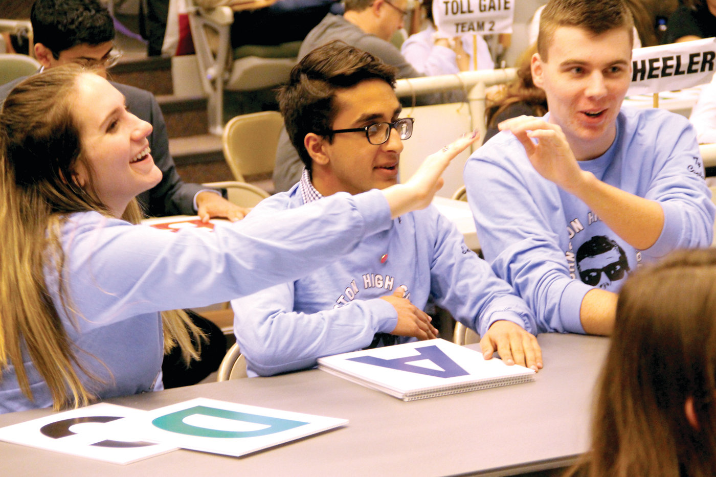 THEY KNOW THE ANSWER: From left to right, Dana Smyth, Shaheer Jamil and Captain Tyler Roche led their team to a second-place finish in the Super Quiz competition this past weekend.