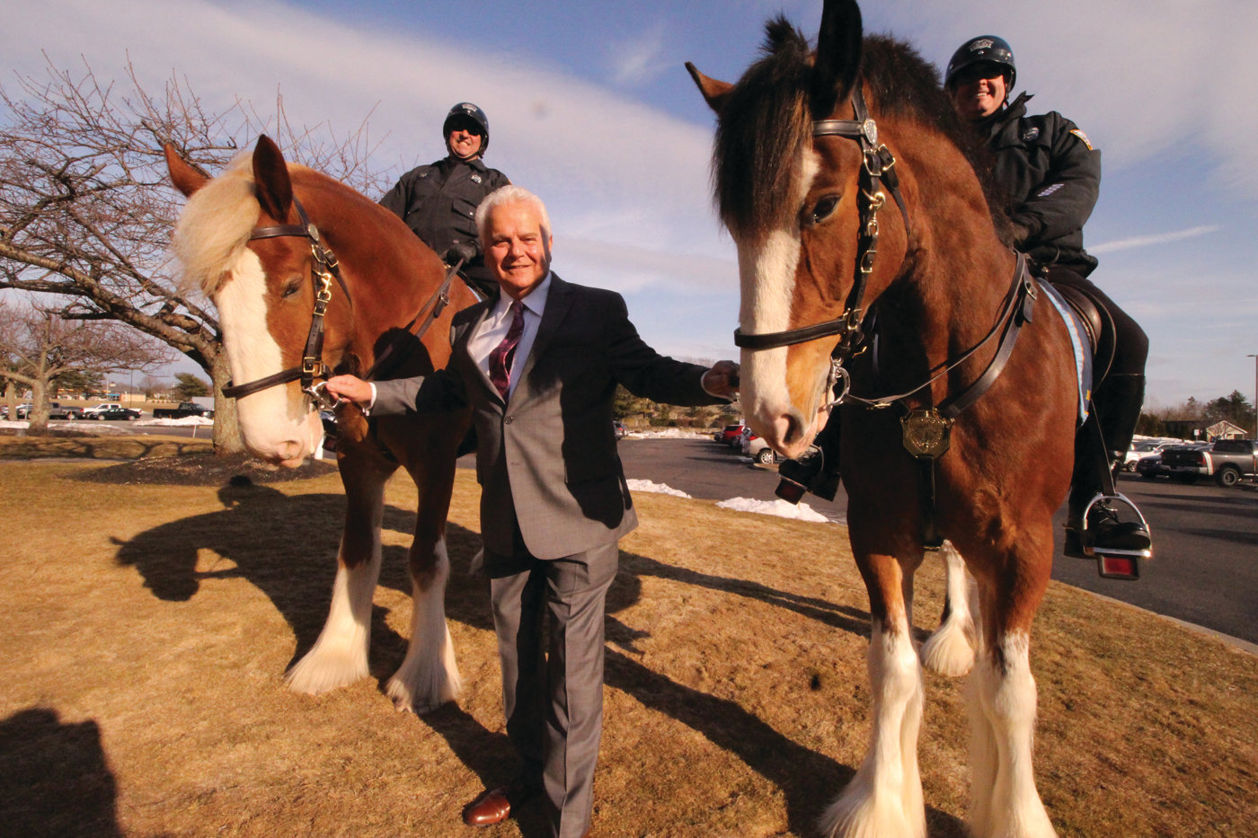 BRING IN THE CAVALRY: Johnston Police Chief Richard Tamburini organized the inclusion of Providence Mounted Unit Clydesdales, which stood tall at the entrance to the Crowne Plaza on Thursday evening.