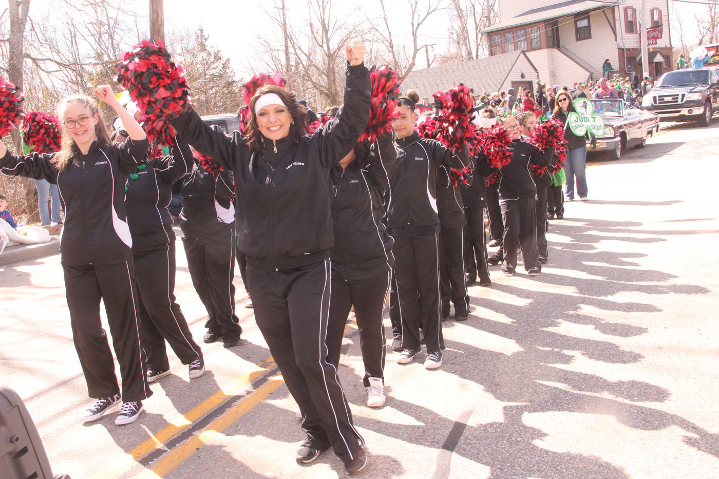 ADDING SPARKLE: Dressed in black with a flash of red…and there was some green, too…the Judy T Dance Studio added vibe to the line of march.