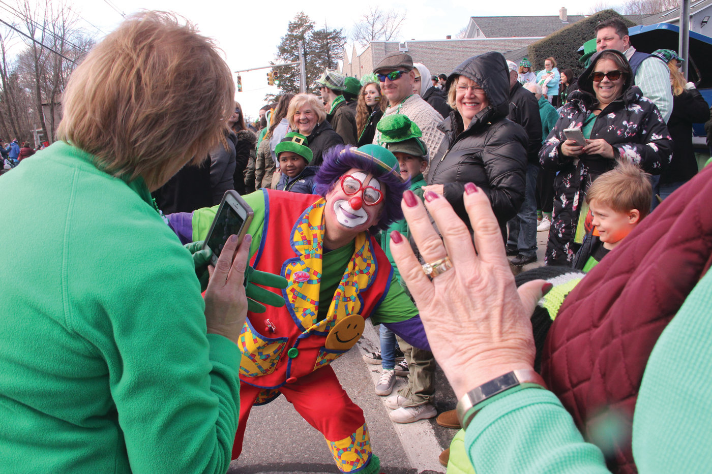 FACE IT, YOU WERE IRISH ON SUNDAY: With ideal conditions, the 60th edition of the West Warwick St. Patrick's Day parade was a festive occasion with the line of march filled with spectators, many of them dressed in more vivid greens than those marching. But few could match the festive colors, and for that matter the smile, of this Shriners clown, who willingly posed for pictures.