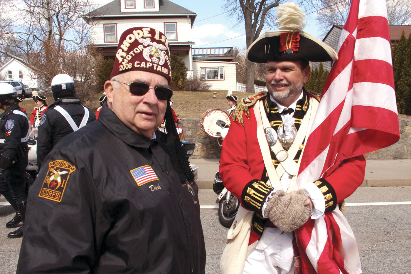 READY AND WAITING: Dick Loring of the Rhode Island Shriners and Ron Barnes of the Pawtuxet Rangers wait to step off at Sunday's parade.