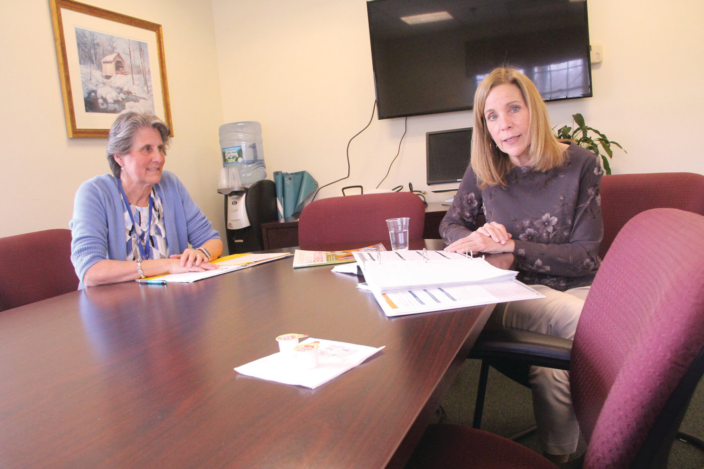 HELPING CAREGIVERS: Kim Morris and Dottie Santagata of Cornerstone Adult Services review procedures of the nationwide Improving Outcomes for Families and Older Adults: Adult Day Service Plus (ADS Plus) research study the center is participating in.