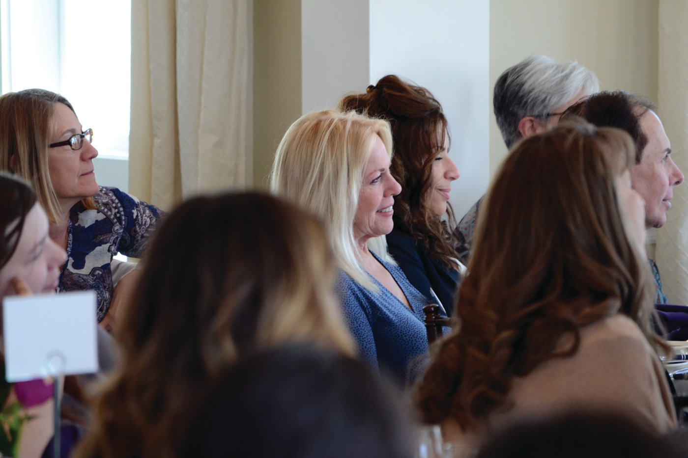 EXTENDING A HELPING HAND: Judith Earle, executive director of the Elizabeth Buffum Chace Center, smiles listening to Drea Kelly give her talk on surviving domestic abuse.