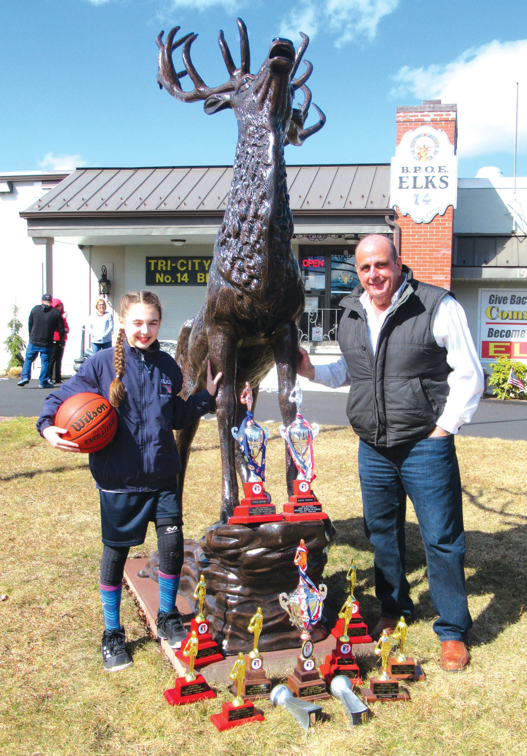 SUPER SENDOFF: Warwick Mayor Joseph J. Solomon joins Tri-City Lodge 14 Champion Sarah Berube and her parents Melissa and Norm Berube beside the new elk statue on West Shore Road for last Saturday's sendoff ceremony for the her entry in the New England championship in South Portland, Maine.