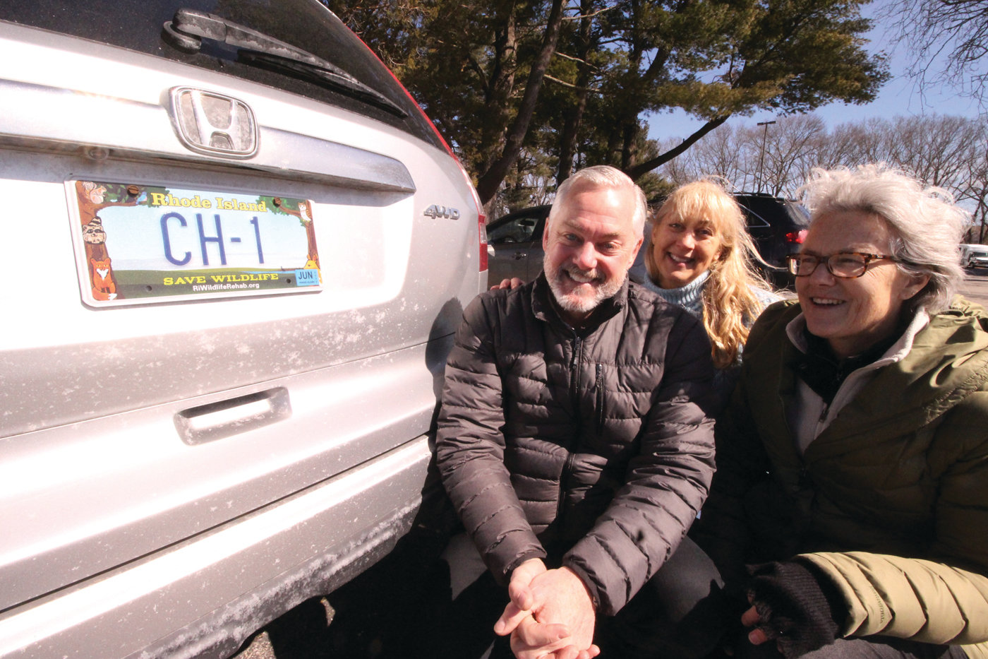 WILD NEW PLATE: As of Saturday, Save Wildlife plates started appearing on cars across Rhode Island. The plate, which has been approved by the General Assembly, benefits the Wildlife Rehabilitators Association of Rhode Island. Pictured with Chuck Hollis of the Division of Motor Vehicles, who ordered a plate for his car, are WRARI executive director Kristin Fletcher and board chair Dr. Lucy Spelman.