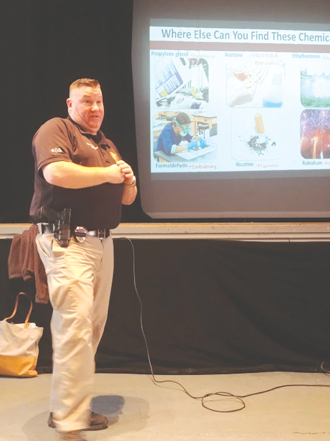 KNOWING THE DANGERS: School Resource Officer Kevin Denneny spoke to the students at Hugh B. Bain Middle School recently about the chemicals contained in e-cigarette pods.