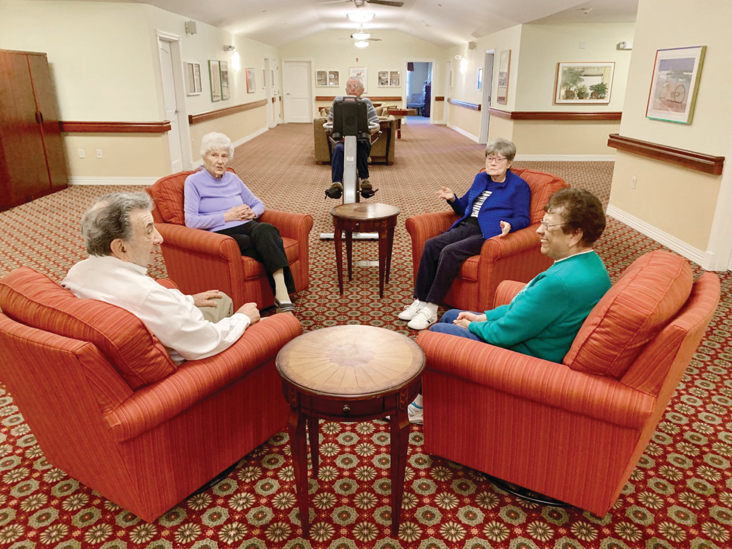 "Residents of Briarcliffe Gardens, an Assisted Living Memory-Care residence in Johnston, try out the residence's new upholstered and comfy ""rocking chairs"" and begin to feel the therapeutic benefits of simply rocking."