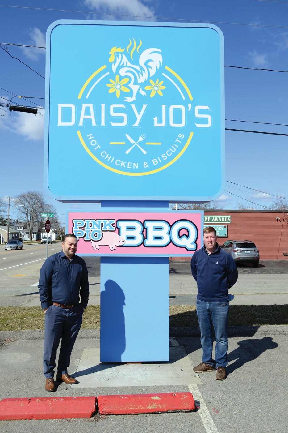 SIGN OF THINGS TO COME: The Pink Pig BBQ sign will soon be gone, but the Daisy Jo's sign will hopefully bring in lots of hungry, curious diners to the new Daisy Jo's, opening this month within a couple weeks, according to co-owners Ed Brady and Jeff Quinlan.