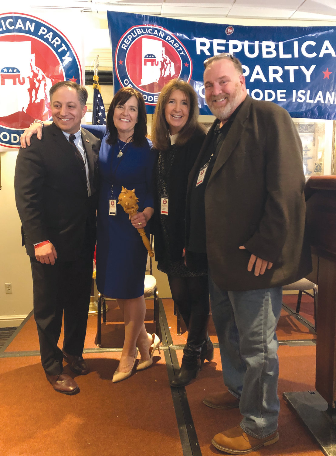IN WITH THE NEW: From left to right, former R.I. GOP Chair Brandon Bell, new R.I. GOP Chair Sue Cienki, former Republican candidate for Mayor of Warwick Sue Stenhouse and Warwick GOP Chairman Rick Cascella posed for a photo just following adjournment Saturday.