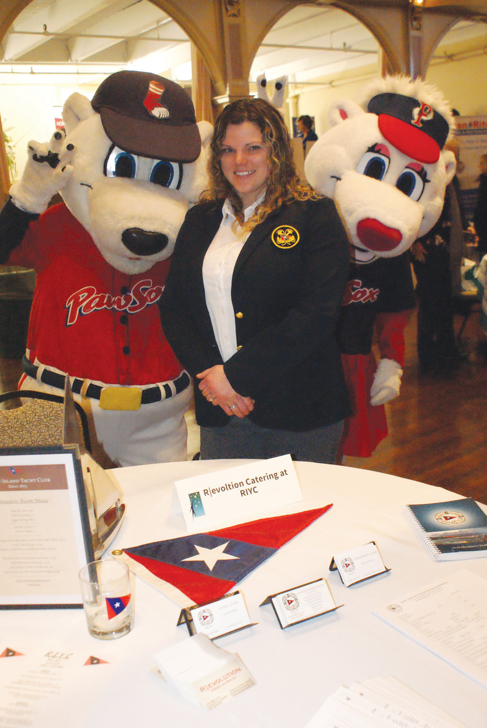 WITH PAWS: Having fun with Paws and Mrs. Paws from the Pawtucket Red Sox was Holly Natale, membership chairperson for the Rhode Island Yacht Club in Cranston.