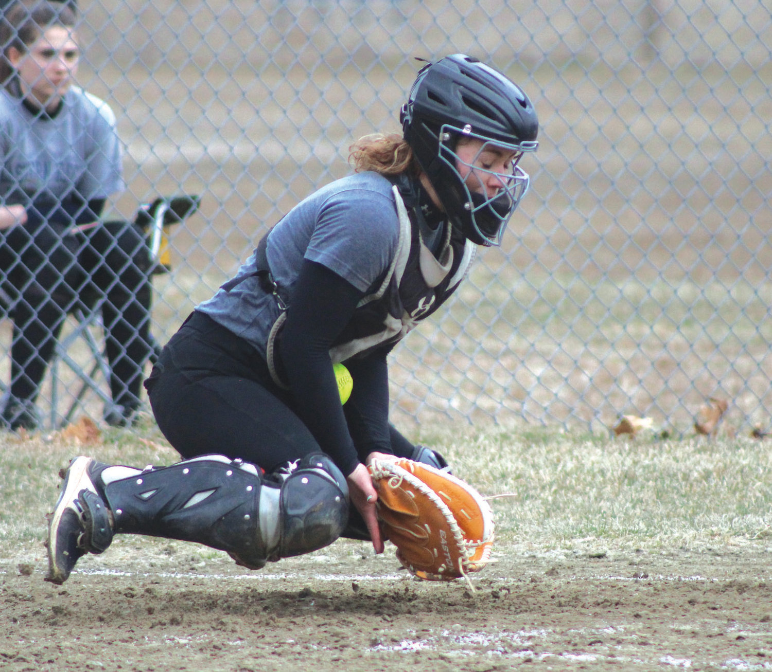 BEHIND THE PLATE: West's Emily Durigan makes a stop against Pilgrim.