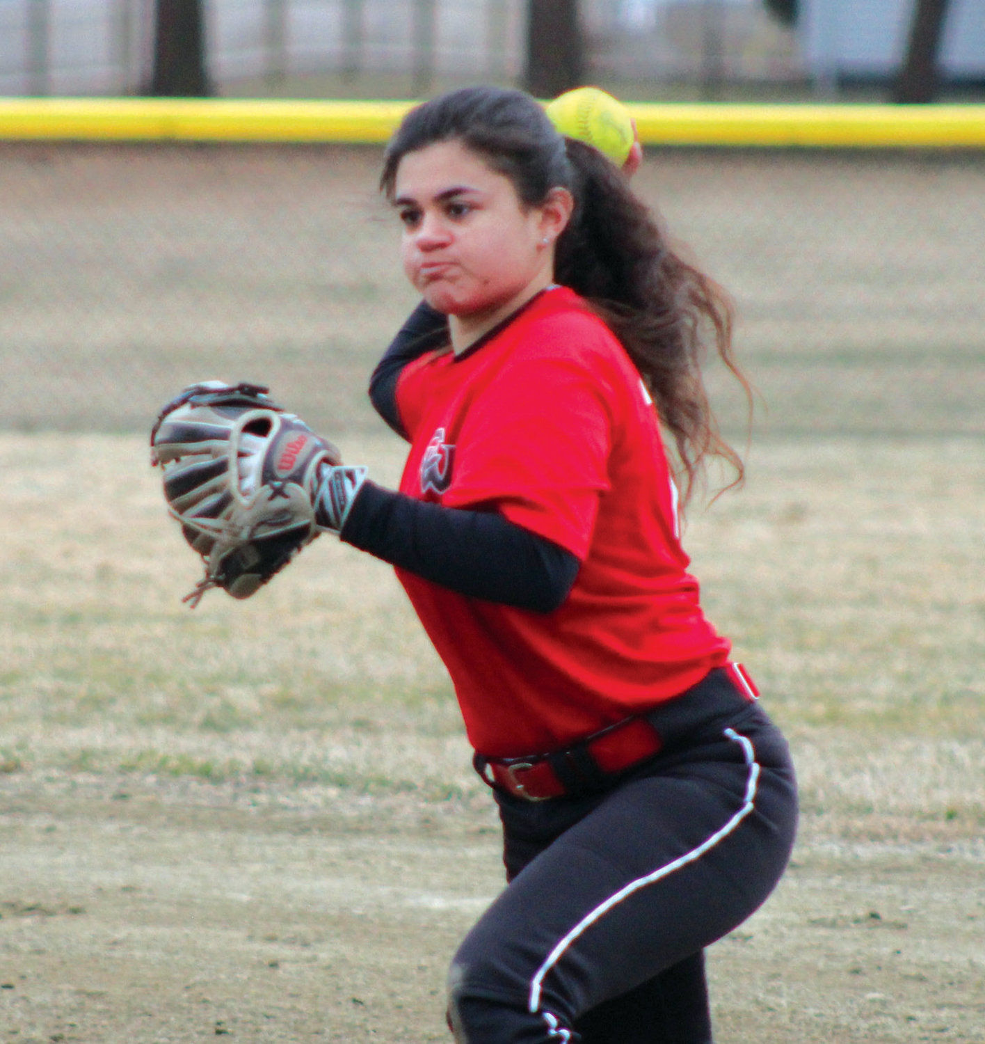 LEADING THE WAY: Cranston West captain Julia Hazian makes a throw to first base during a scrimmage against Pilgrim last week at Pilgrim High School. Hazian is expected to be one of the Falcons' top performers this season, and is one of the top all-around players in Division I.