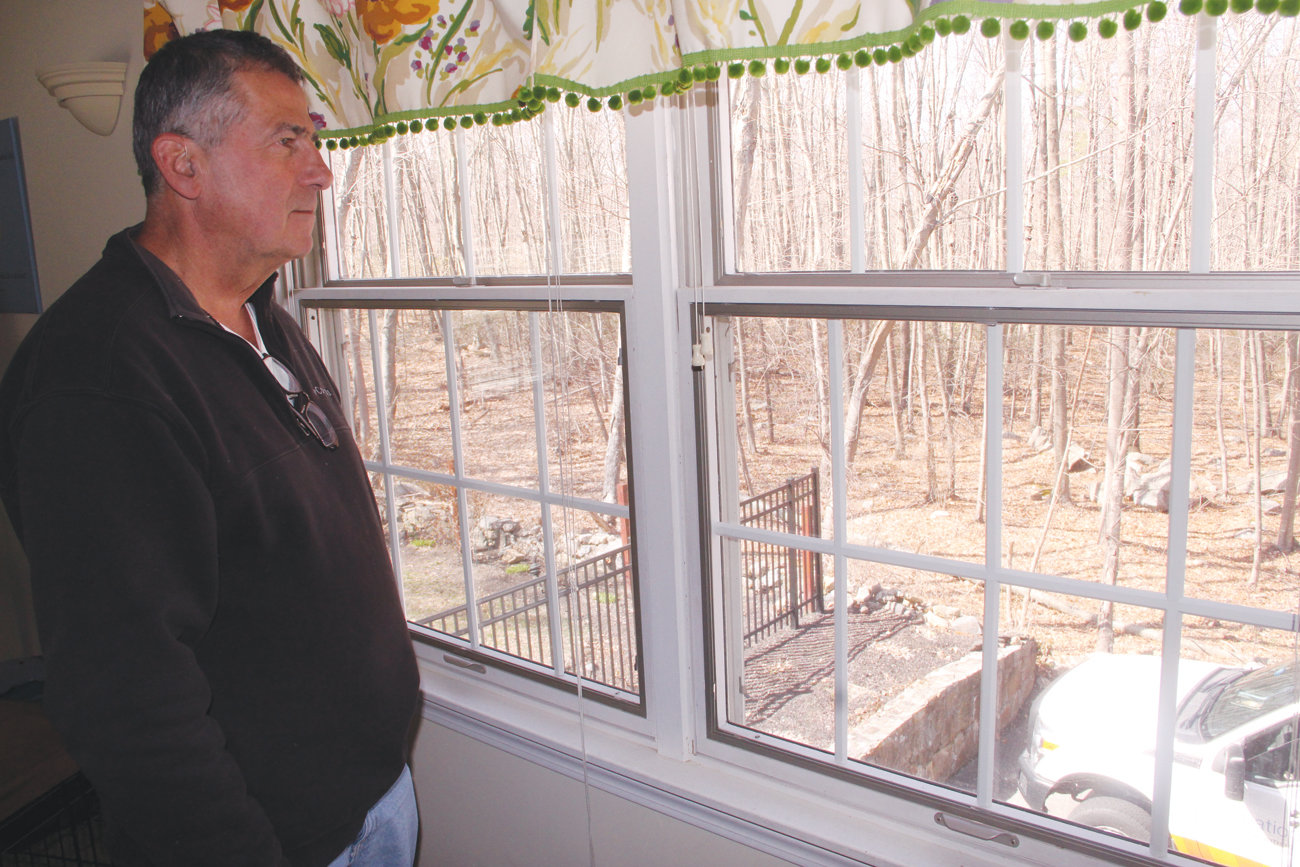 WHO WILL BE HIS NEIGHBOR: Gary Gliottone of Blue Ridge Road looks out on woodlands that are part of the Little Rhody Beagle Club. The club is proposing leasing 44 acres for the construction of a solar farm.