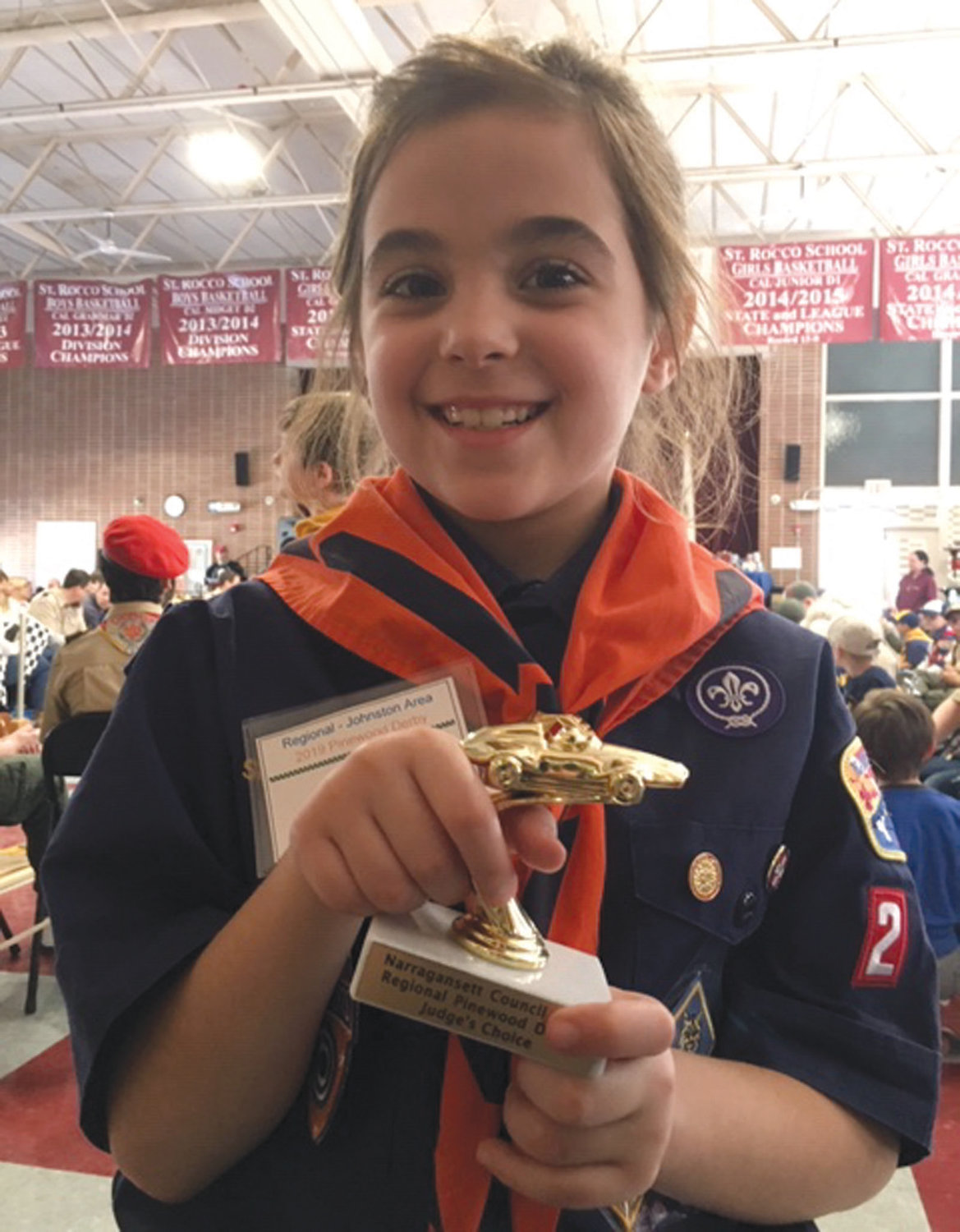 NOTHING BUT HAPPY: Johnston's Ali LaFazia proudly holds her award for Judge's Choice in design during the Pinewood Derby Regionals in March. Ali, via her mother Sheri, said her favorite aspects of Boy Scouts include hiking, fishing and camping.