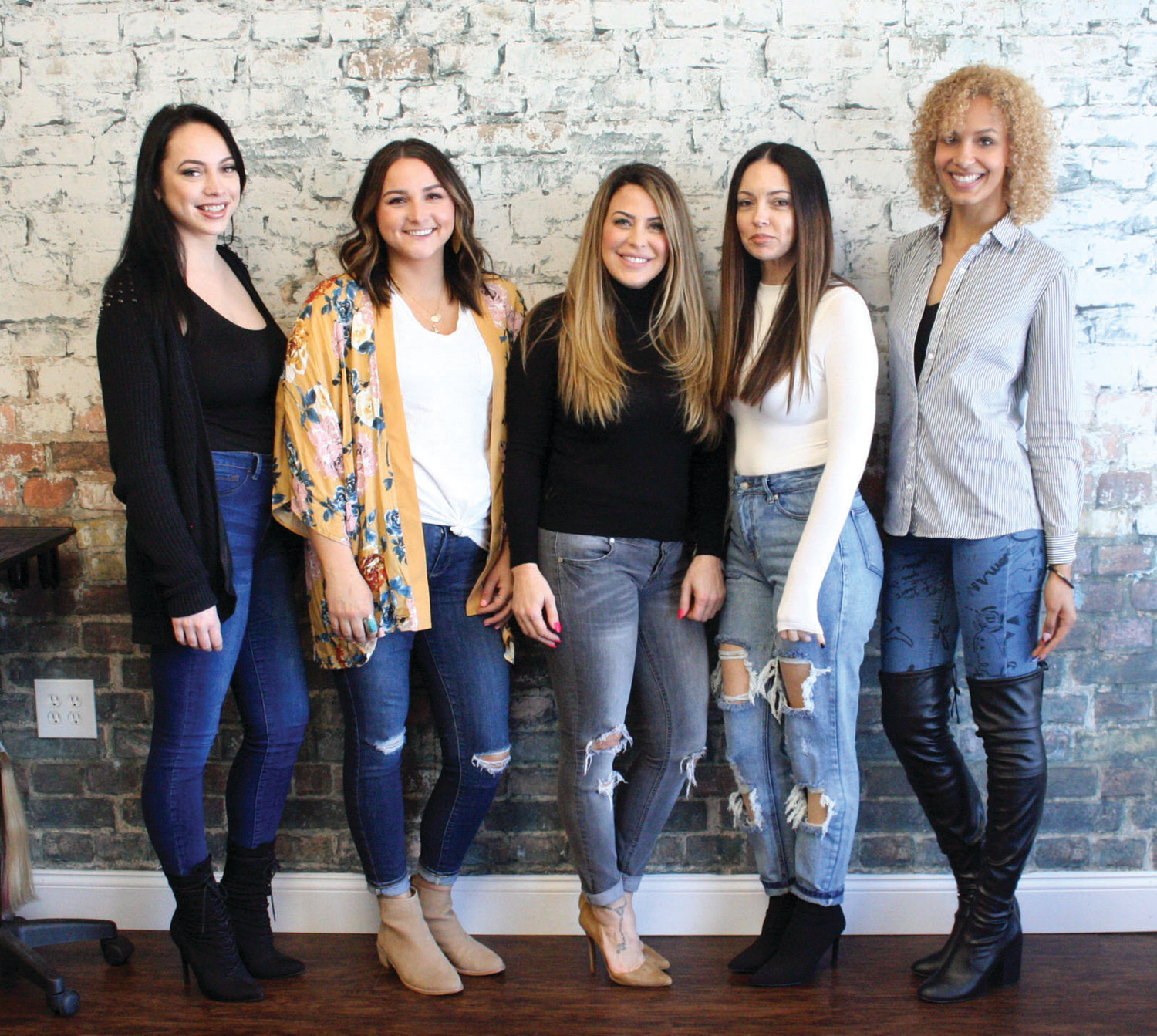 SARA'S TEAM: Elysian Beauty Studio owner Sara Bruno (center) -- pictured from left to right with team members Willow, Tori, Reena and Kayla -- said that she loves being able to inspire confidence at her business every day.