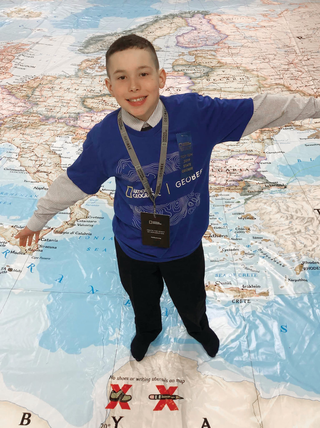 ON TOP OF THE WORLD: Aidan Paplaskaus, a fifth-grader from St. Mary's School, was the only Cranston student to make it to the top 10 at the state GeoBee competition on March 29.