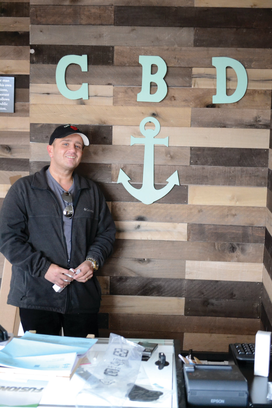 HERE TO HELP: CBD Store owner Mike Lanoue doesn't proclaim that CBD can cure all ailments, but he has firsthand reason to believe in its healing powers. He offers anyone free samples to try for themselves.