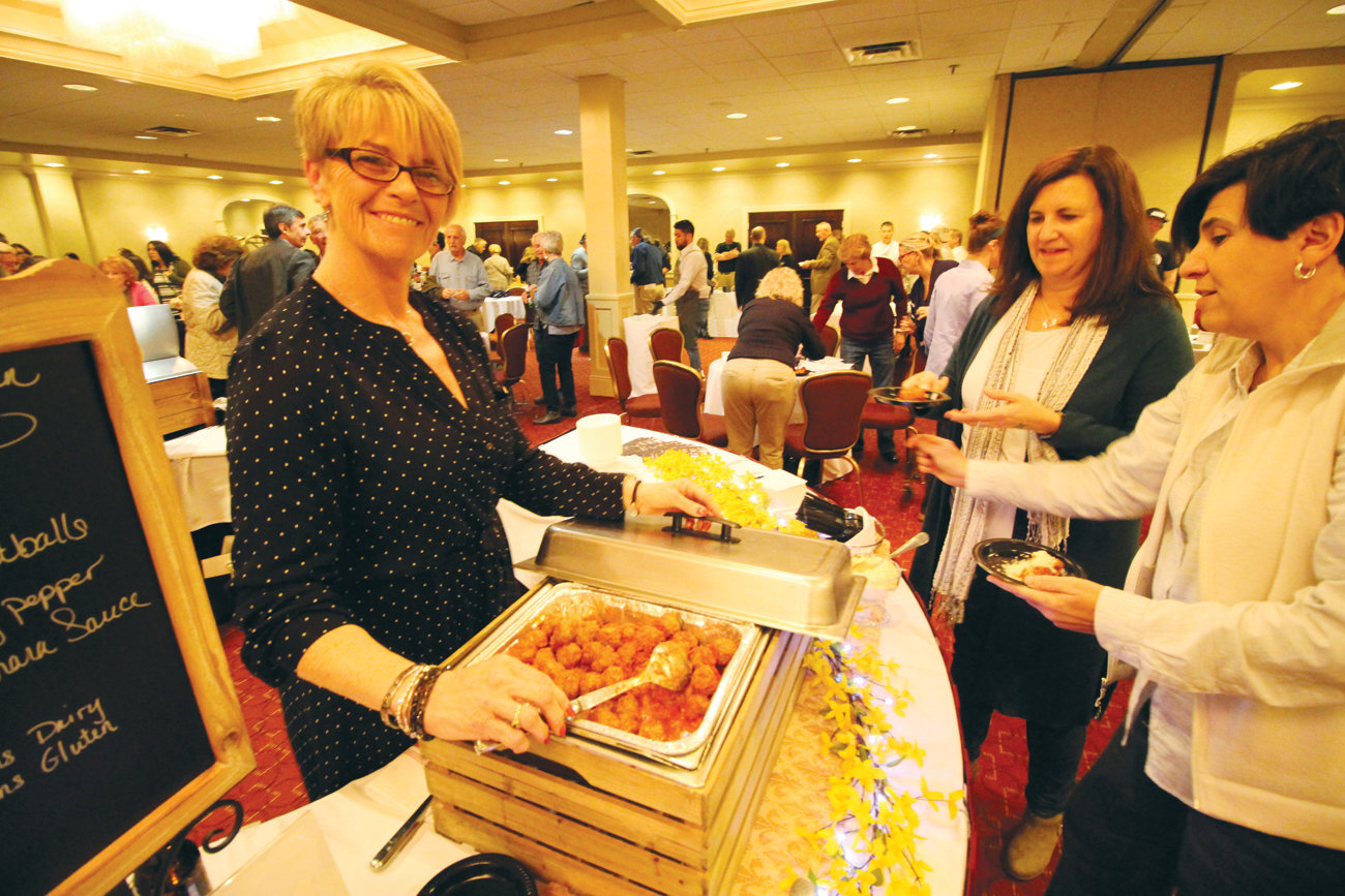 A REGULAR: Sophia's Tuscan Grille on Warwick Avenue has participated in the gala since it was started. Here Kim Caimano serves up meatballs.