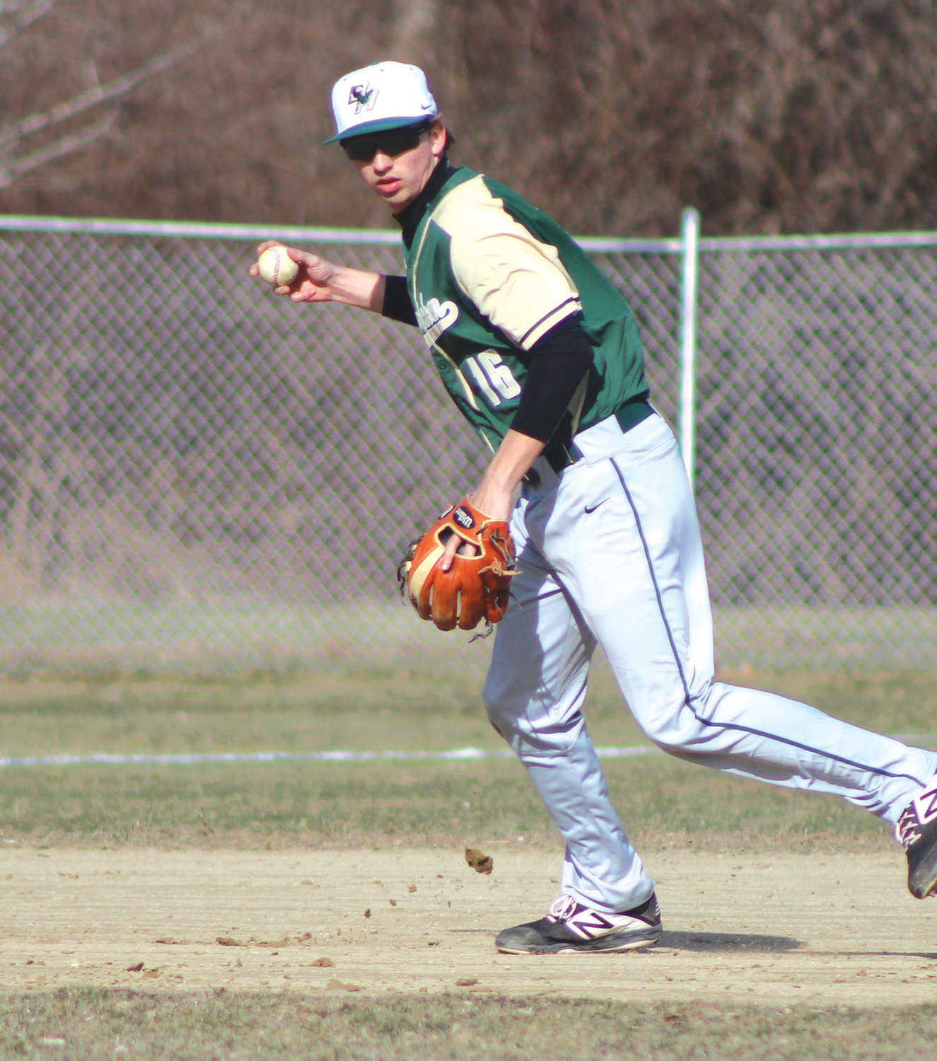 PLAYING THE FIELD: Bishop Hendricken's Colin Lemieux throws to first base in the second inning against Cumberland last week. The Hawks cruised to a 19-5 victory.