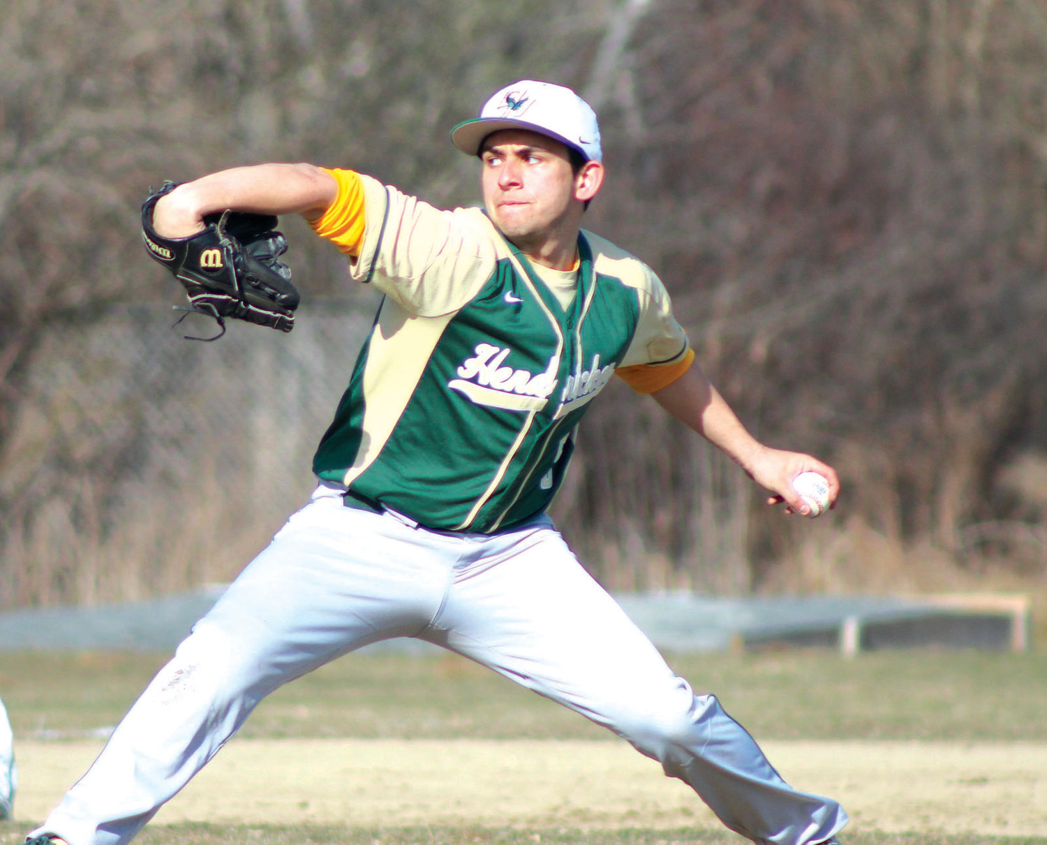 ON THE HILL: Bishop Hendricken's Kyle Marrapese gets set to deliver.