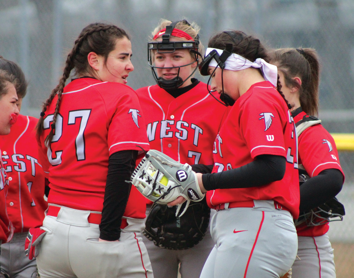 TALKING IT OUT: Members of the Cranston West infield meet during a timeout against Pilgrim.