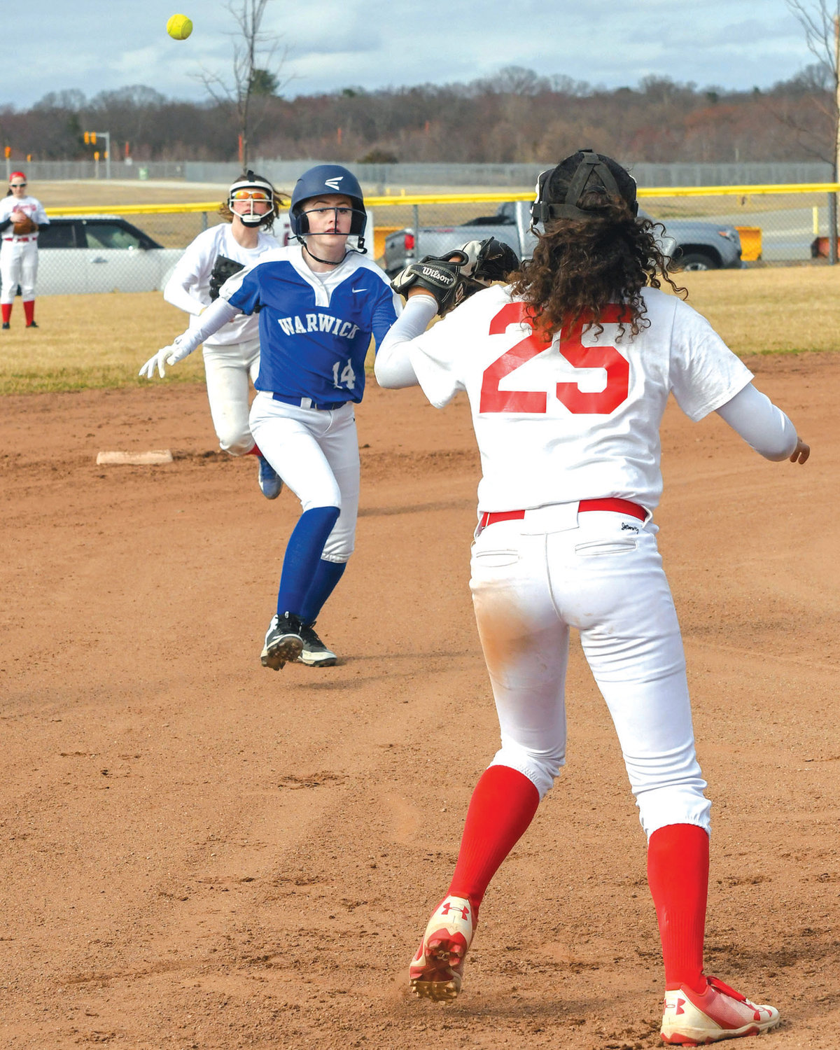 RUNDOWN: Vets' Olivia Bordeleau runs to third during a rundown against Winman.
