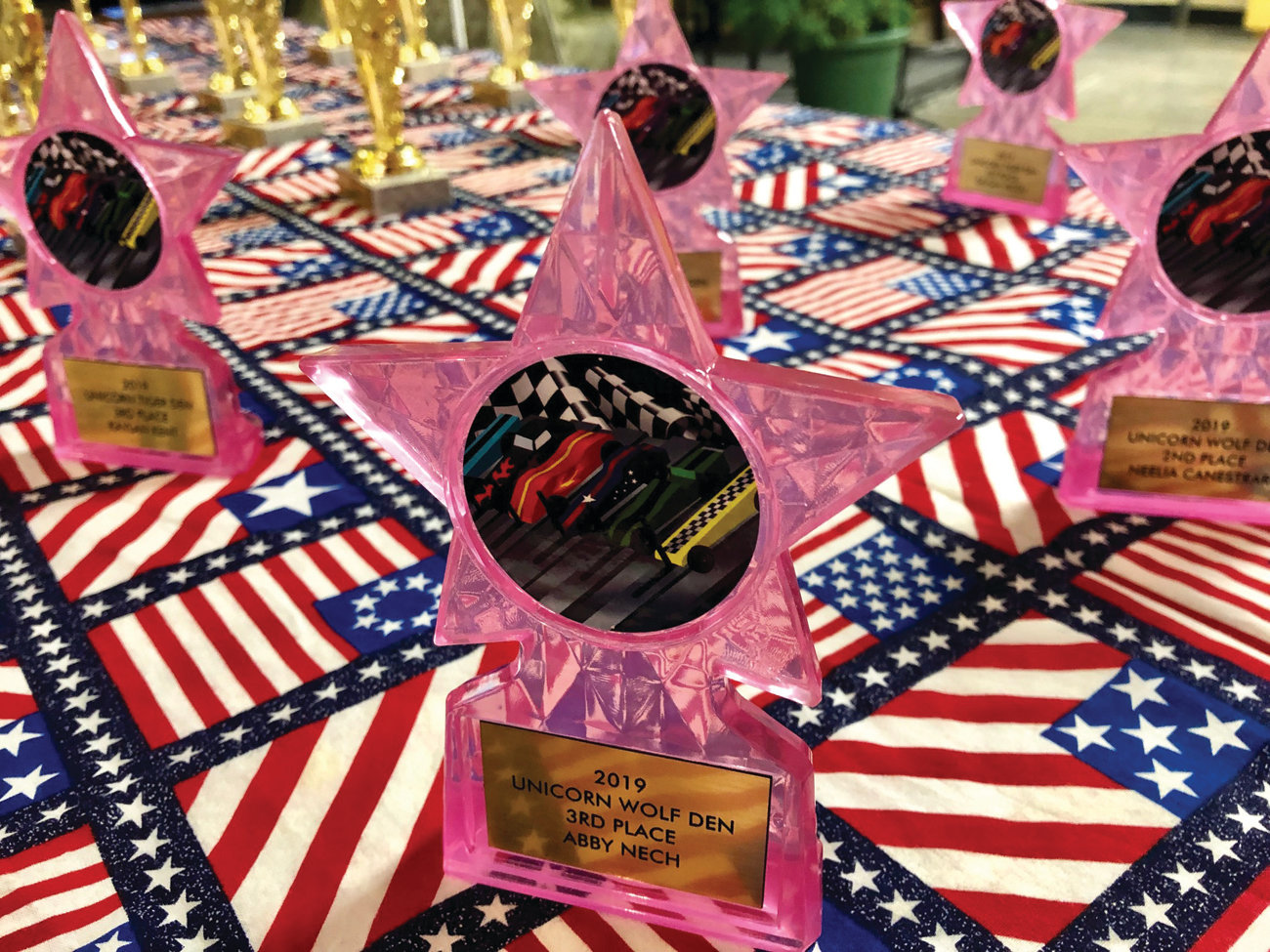 Shiny pink trophies await their Unicorn recipients.