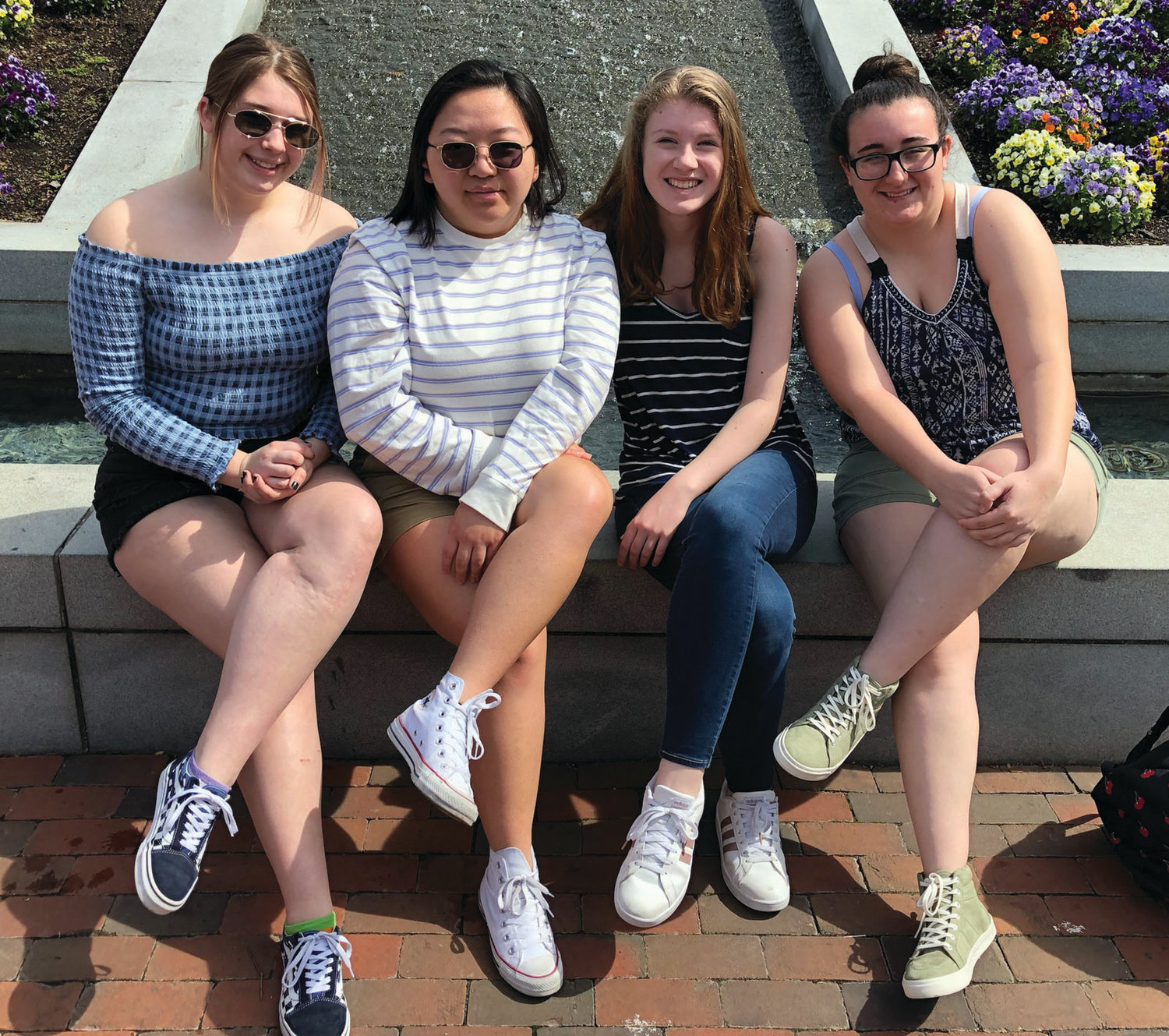 MUSIC MATES: Johnston High music students Kelsey Scott, Marilou Kue, Ashlyn Banno and Sophia DaCosta enjoy a lighter moment during last weekend's trip to Williamsburg.