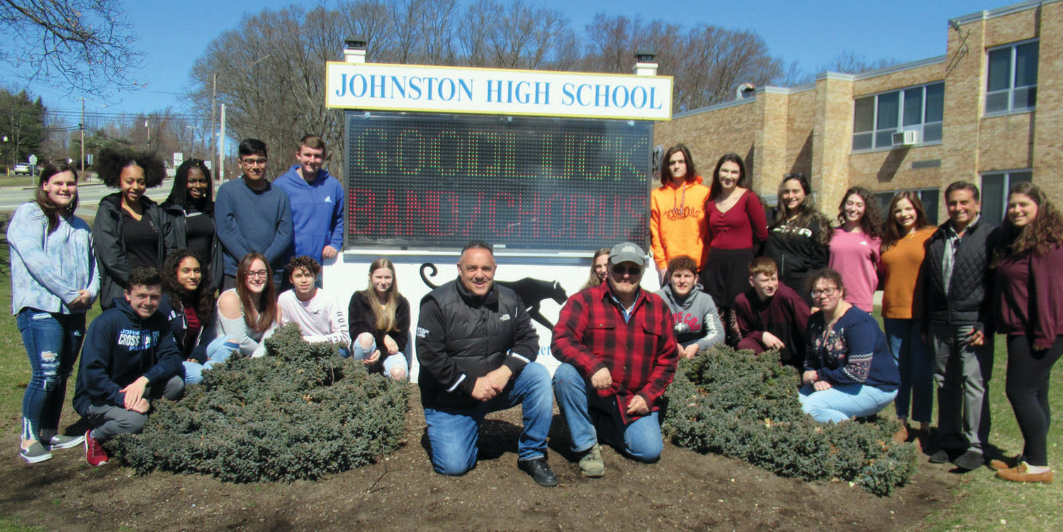 PROUD PANTHERS: Members of the Johnston High School Student Council and adviser Greg Russo gather with Gary Salzillo and John Eramian in front of the school's first-ever digital sign during last Thursday's dedication.