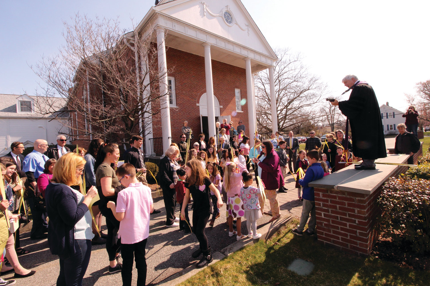 THE JOY OF THE SEASON: Pastor Stephen Clark leads the congregation in song outside Greenwood Community Church, Presbyterian.