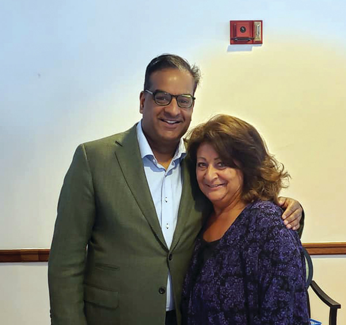 REAL LIFESAVER: Neurosurgeon Dr. Prakash Sampath is pictured with one of his patients, Caroline Caprio, who has recovered after surgery to remove a large brain tumor. Caprio now helps support the Rhode Island Brain and Spine Tumor Foundation through events such as the upcoming Fiesta at the Imperial Room in Cranston.