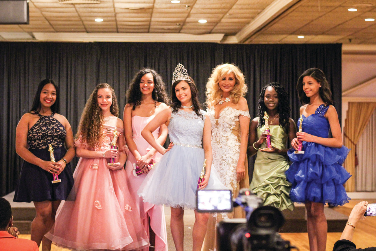 "A TOUCH OF ROYALTY: Cranston resident Lily Addonizio, center, was the winner in the girls 11-14 category at the ""A Touch of Royalty Pageant"" held recently in Swansea. She received the title of ""Northeast of America Young Miss."" Also pictured (from left) are Leticia Castillo Rosario, Kathleen Medeiros, Isabella James Indellicati, Claudia Gizzarelli, Success Bleh and Jesatey Zapata."