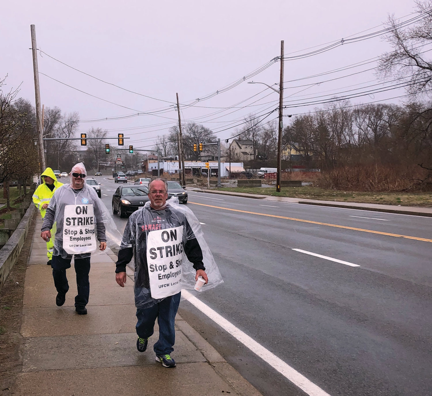 BRAVING THE ELEMENTS: Workers take part in a demonstration outside the Stop & Shop location on Warwick Avenue in Cranston on Friday. The strike entered its sixth day on Tuesday.