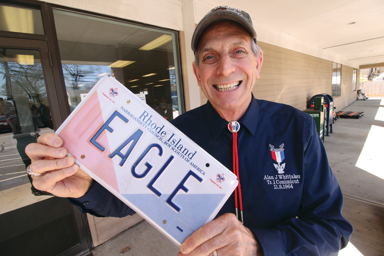 "FUTURE PLATE: Alan J. Whittaker with the Narragansett Council Boys Scouts of America plate that will become available to Rhode Islanders once 600 pre-orders have been made. As for ""Eagle,"" Whittaker has had that plate since the 1960s and he plans on keeping it."