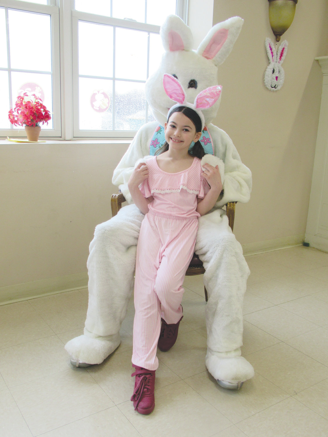 PRETTY IN PINK: Eveling DeSimone, 7, wore a lovely pink outfit and pink-accented ears to have her picture taken with the Easter Bunny Saturday morning.